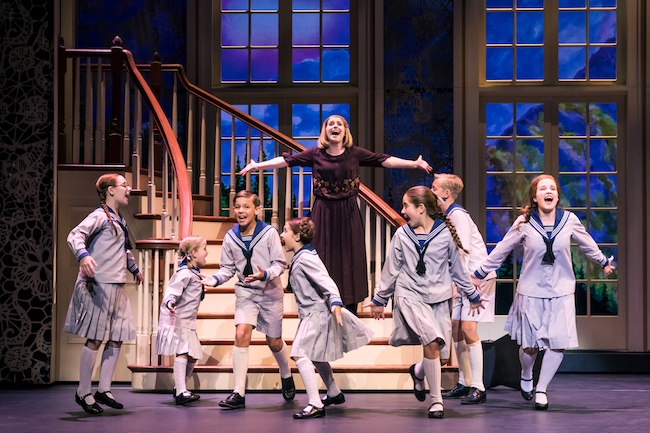 Jill-Christine Wiley as Maria Rainer and the von Trapp children Photo by Matthew Murphy