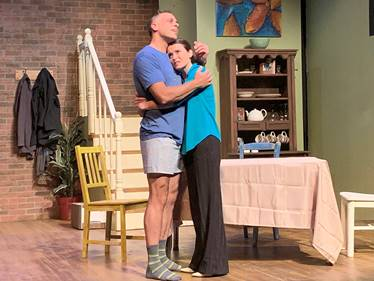 Julie Layton and Isaiah Di Lorenzo in a scene from Michael Weller's 'Fifty Words' at St Louis Actors Studio.