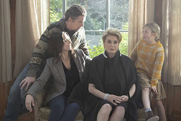 The Truth cast of Ethan Hawke, Juliette Binoche, Catherine Deneuve, Hirokazu Koreeda and Clémentine Grenier sit on a couch