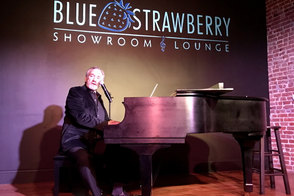 Rick Jensen at the Blue Strawberry. Photo by Chuck Lavazzi.