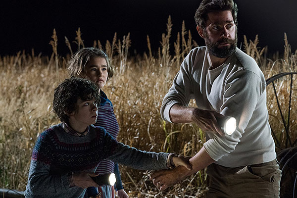 John Krasinski, Noah Jupe, and Millicent Simmonds in A Quiet Place (2018). Photo Credit: Jonny Cournoyer - © 2018 Paramount Pictures. All rights reserved.