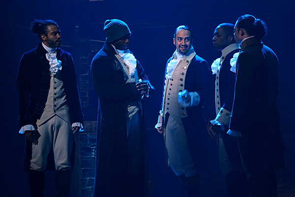 Lin-Manuel Miranda, Leslie Odom Jr., Okieriete Onaodowan, Daveed Diggs and Anthony Ramos perform on stage.