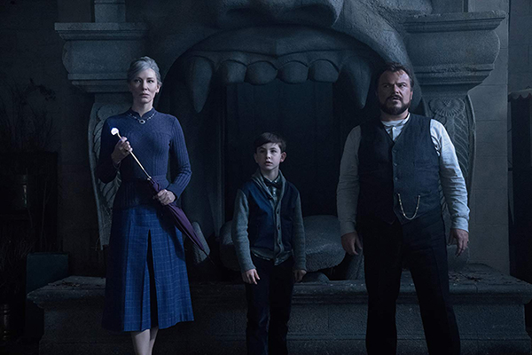 Cate Blanchett, Jack Black, and Owen Vaccaro in The House with a Clock in Its Walls
